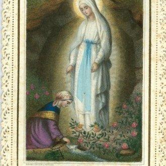 Színes szentkép díszes papírcsipke keretezéssel